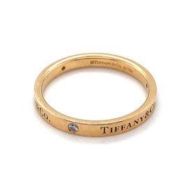 Occasion originele Tiffany & Co gouden band ring met 0.12ct diamant