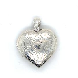 Occasion groot zilveren hartvormig medaillon met gravures