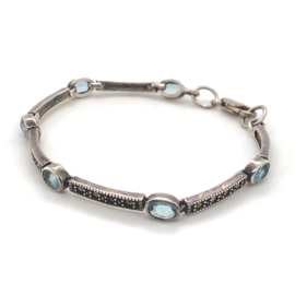Occasion zilveren markasiet armband met blauwe topaas