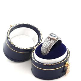 Occasion zilveren bewerkte ring met topaas