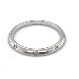 Occasion witgouden schuine aanschuifring met diamant 0.12ct