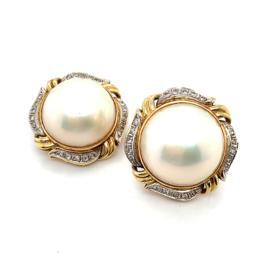Occasion gouden oorclips met parelmoer en diamant