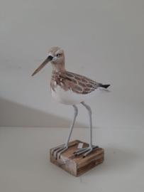 Vogel op blok lopend