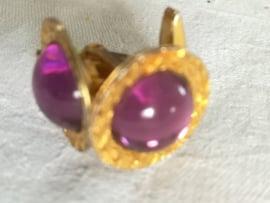 Manchetknopen goudkleurig met paars glas