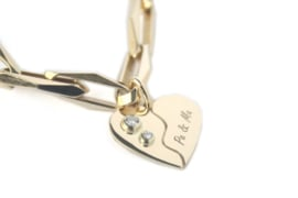 Gouden hartjes bedel met diamant van 'oud goud'