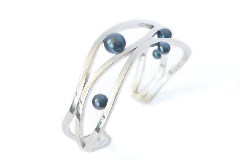 Zilveren golf-armband met parels