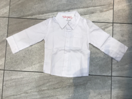 Witte baby blouse.
