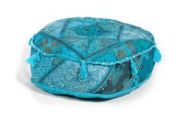 Oosterse poef patchwork blauw met kwastjes.