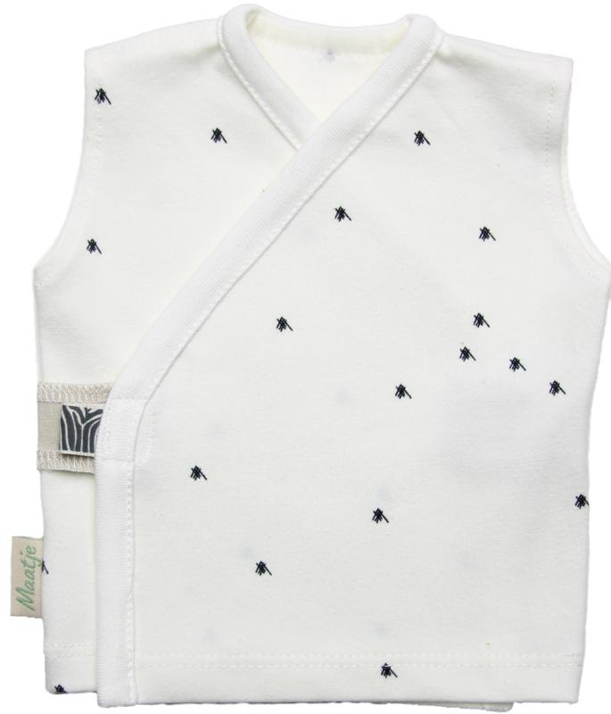 Neutraal overslag hemdje met kleine zwart accentjes