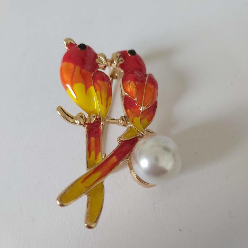 Kleuren combi broche (rood | vogel2)