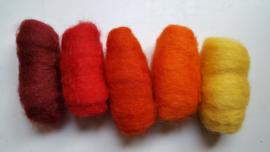 Gekaarde wol assorti rood-en oranjetinten, geel (nr 154)
