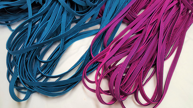 Elastiek band, magenta of blauw