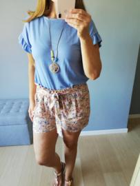 losse blousetop met ronde cirkelketting jeansblauw