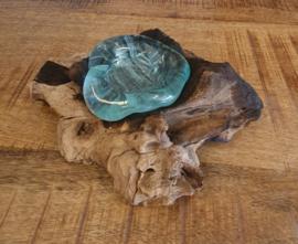 Geblazen glas op hout