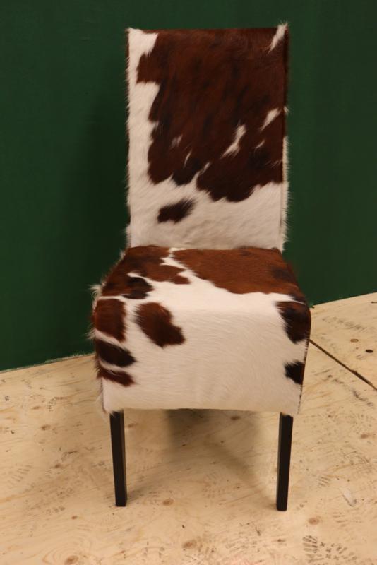 Koeienhuid eetkamer stoel bruin wit.   Eetkamerstoel   Cows