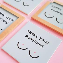 Tegel met grappige tekst  SHAKE YOUR POMPOMS - lichtblauw 15 cm x 15 cm