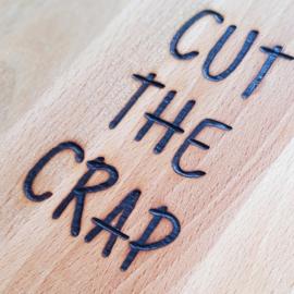 Ronde snijplank met de grappige tekst CUT THE CRAP - Beukenhout met een diameter van 25 cm