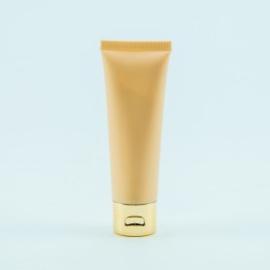 Handcrème kleur pech met gouden dop (inhoud 50 ml)