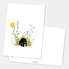 Huis met bloemen