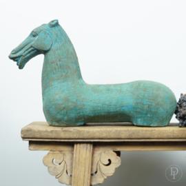 Blauwgroen ijzeren paard