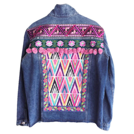 Embellished denim jacket colored with big pompons