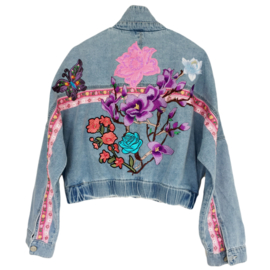 Embellished denim jacket with big flower patches in pink and purple