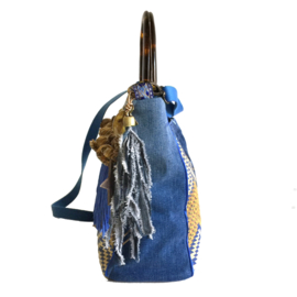 Boho handbag in blue yellow with fringe and jeans