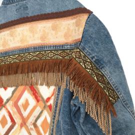 Embellished denim jacket in boho western style with fringe