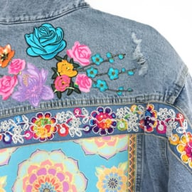 Embellished denim jacket with multi colored flower patches