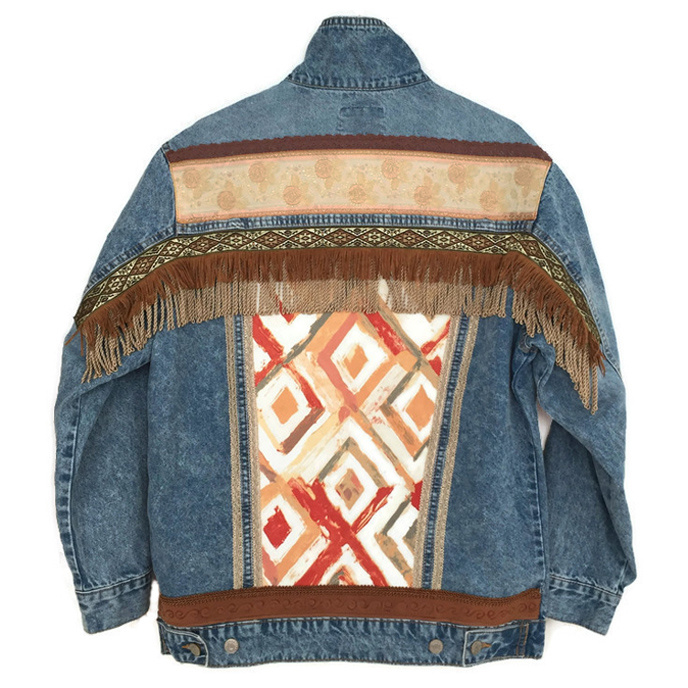 Embellished denim jacket in boho western style with fringe