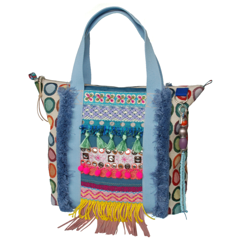 Ibiza tote handbag colored with fringes and jeans