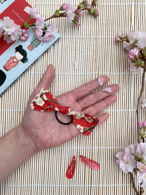 Haarstrik - rood met Japanse pruimenbloesem