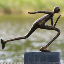 Bronzen schaatser