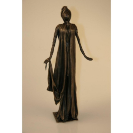 Bronze colored figure with long robe
