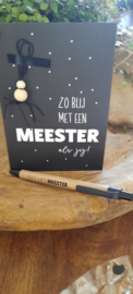Pen en kaart met gelukspoppetje meester