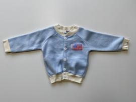 Fleece jasje licht blauw met witte boorden