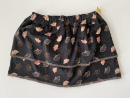Tricot/stretch rokje 2 lagen, zwart met bloemblaadjes en elastische zwarte band