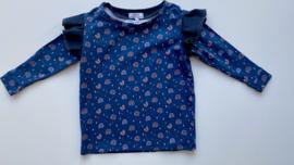 Shirtje Tricot/stretch blauw met donkerblauwe ruffles met regenboogjes