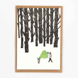 "Studio Flash • kerstkaart ""carrying a christmas tree"""