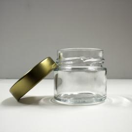 glazen potje met goudkleurig schroefdeksel