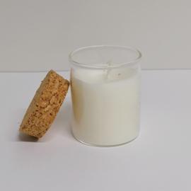 witte kaars in glazen potje met kurk