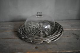 Glazen stolp met rieten plateau