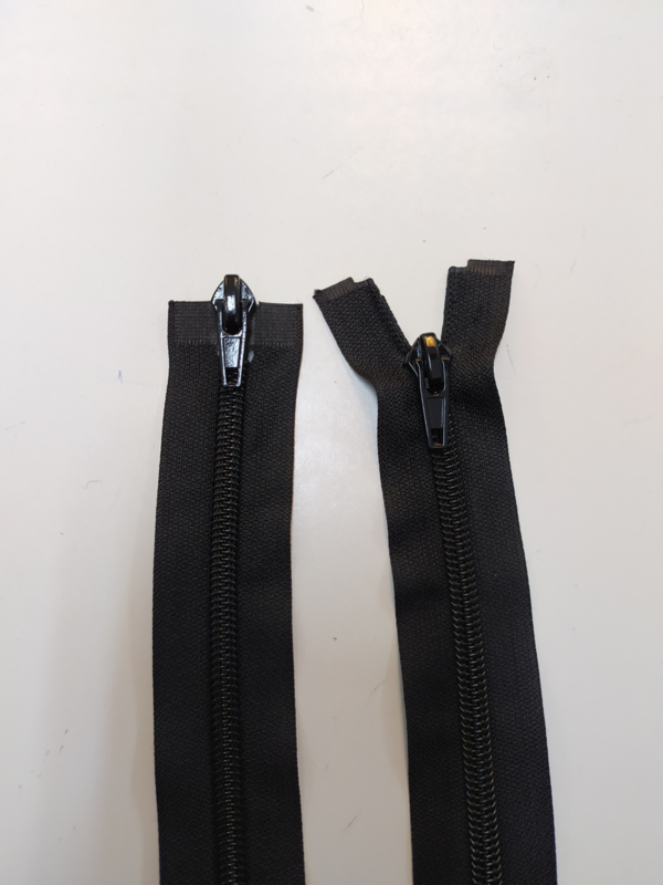 Plastic/spiraal Dubbelrunner jas rits 110 cm!  Zwarte kleur