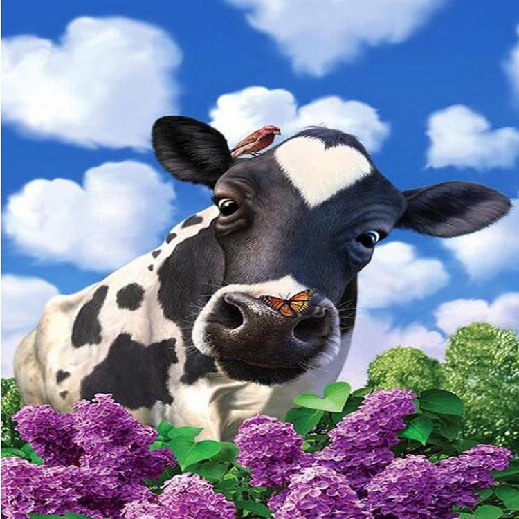 een koe achter bloemen 40X50 CM