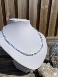 Bergkristal - blauw glaskraaltje