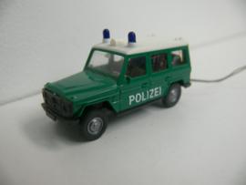 Wiking Mercedes G Klasse Polizei met werkende zwaailichten