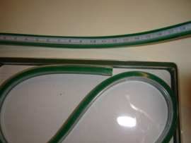 Flexible curve ruler with graduation.