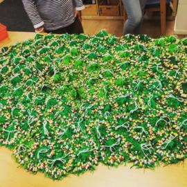 Heel veel groene gelukspoppetjes