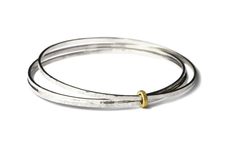 Zilveren gesmeedde armbanden met gouden oog