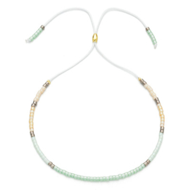 Verstelbaar armbandje mini beads licht groen